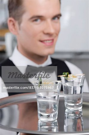 Waiter holding a tray of tequila shots Stock Photo - Rights-Managed, Image code: 837-03073957