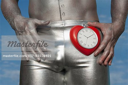 Mid section view of a gay man holding a heart shape clock,Washington DC,USA Stock Photo - Rights-Managed, Image code: 837-03074921