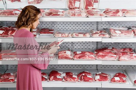 Woman buying meat in a supermarket Stock Photo - Rights-Managed, Image code: 837-03075001