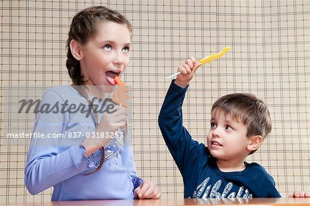 Boy and his sister holding candies Stock Photo - Rights-Managed, Image code: 837-03183253