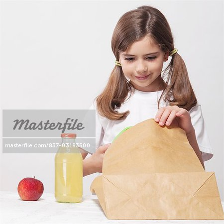 Girl packing lunch for school Stock Photo - Rights-Managed, Image code: 837-03183500