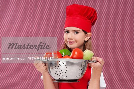 Portrait of a girl holding a colander full of fresh vegetables Stock Photo - Rights-Managed, Image code: 837-03183817