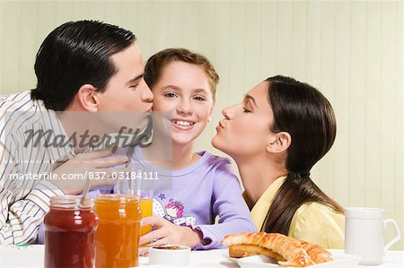 Couple kissing their daughter Stock Photo - Rights-Managed, Image code: 837-03184111
