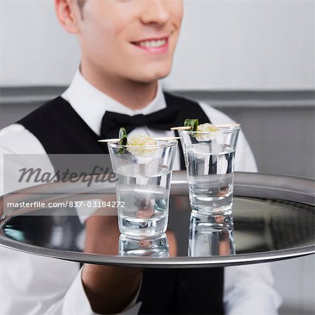 Waiter holding a tray of tequila shots Stock Photo - Rights-Managed, Image code: 837-03184272