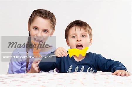 Boy and his sister eating candies Stock Photo - Rights-Managed, Image code: 837-03184581