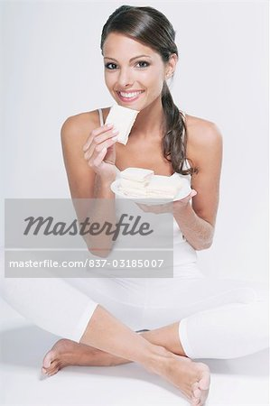Portrait of a woman eating a sandwich Stock Photo - Rights-Managed, Image code: 837-03185007