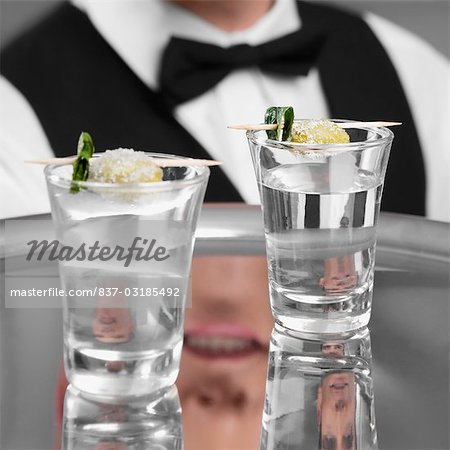 Waiter holding a tray of tequila shots Stock Photo - Rights-Managed, Image code: 837-03185492