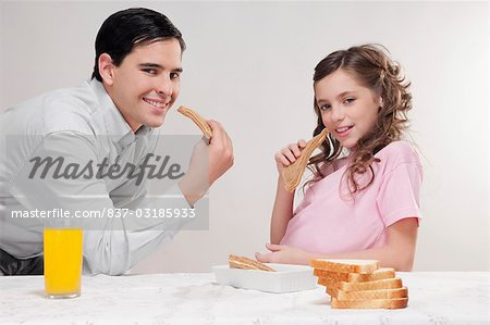 Man with his daughter at a breakfast table Stock Photo - Rights-Managed, Image code: 837-03185933