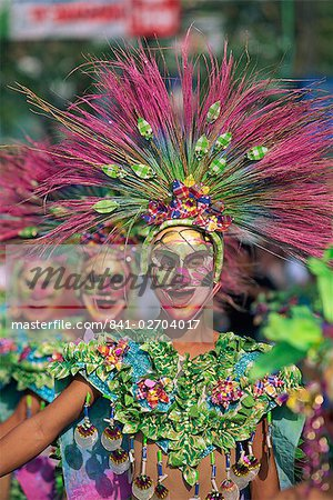 Portrait of a masked dancer in colourful costume at Mardi Gras carnival, in Iloilo City on Panay Island, Philippines, Southeast Asia, Asia Stock Photo - Rights-Managed, Image code: 841-02704017