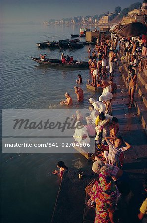 Pilgrims on the ghats by the River Ganges (Ganga), Varanasi (Benares), Uttar Pradesh State, India, Asia Stock Photo - Rights-Managed, Image code: 841-02704506