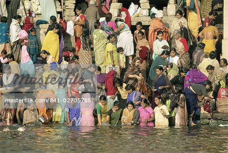 Hindus bathing in the early mornin in the holy river Ganges (Ganga) along Dasaswamedh Ghat, Varanasi (Benares), Uttar Pradesh state, India, Asia Stock Photo - Rights-Managed, Image code: 841-02705785