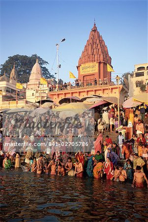 Hindus bathing in the early morning in the holy river Ganges (Ganga) along Dasaswamedh Ghat, Varanasi (Benares), Uttar Pradesh state, India, Asia Stock Photo - Rights-Managed, Image code: 841-02705786