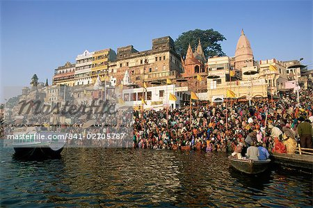 Hindu pilgrims bathing in the early morning in the holy river Ganges (Ganga) along Dasaswamedh Ghat, Varanasi (Benares), Uttar Pradesh state, India, Asia Stock Photo - Rights-Managed, Image code: 841-02705787