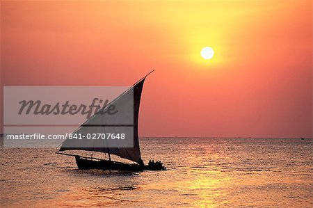 Dhow in silhouette on the Indian Ocean at sunset, off Stone Town, Zanzibar, Tanzania, East Africa, Africa Stock Photo - Rights-Managed, Image code: 841-02707648