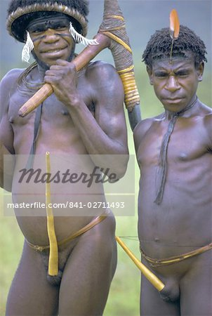 Portrait of two Dani tribesmen wearing penis gourds, Irian Jaya (West Irian) (Irian Barat), New Guinea, Indonesia, Asia