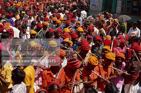 Flute players of the Bhil tribe in the Rathwa Clan Parade through the streets at the Spring Festival, Kawant, Gujarat, India, Asia