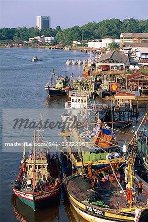 Fishing boats moored on the Terengganu River at Kuala Terengganu, capital of the state of Terengganu, Malaysia, Southeast Asia, Asia