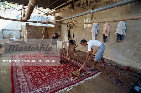 Washing newly made carpets to tighten pile and clean out dyes, Jaipur, Rajasthan state, India, Asia Stock Photo - Rights-Managed, Image code: 841-02826146