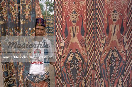 Portrait of a man and ikat design, Sumba (Soemba), Lesser Sundas, Indonesia, Southeast Asia, Asia Stock Photo - Rights-Managed, Image code: 841-02831301