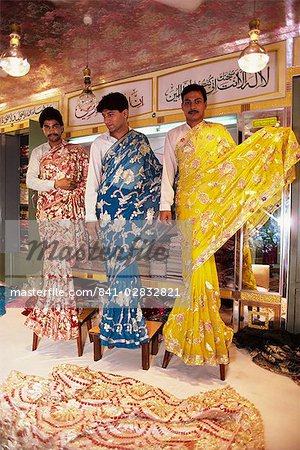 Salesmen modelling saris in a textile and silk sari shop, Anarkali Bazaar, Lahore, Pakistan, Asia Stock Photo - Rights-Managed, Image code: 841-02832821