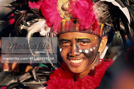 Portrait of a man with facial decoration and head-dress with feathers at Mardi Gras carnival, Dinagyang in Iloilo City on Panay Island, Philippines, Southeast Asia, Asia Stock Photo - Rights-Managed, Image code: 841-02899066