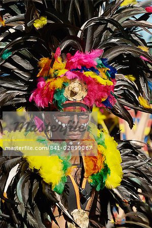 Portrait of a man with facial decoration and head-dress with feathers at Mardi Gras carnival, Dinagyang in Iloilo City on Panay Island, Philippines, Southeast Asia, Asia Stock Photo - Rights-Managed, Image code: 841-02899067