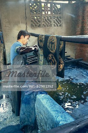 Dipping batik in an indigo vat, Guizhou, China, Asia Stock Photo - Rights-Managed, Image code: 841-02901352
