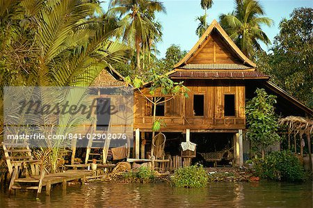 A traditional Thai house on stilts above the river in Bangkok, Thailand, Southeast Asia, Asia