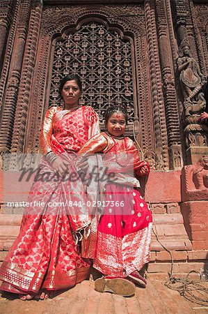 Mother and daughter stand in temple doorway at Kumari (living goddess) festival, Durbar Square, Kathmandu, Nepal, Asia Stock Photo - Rights-Managed, Image code: 841-02917366