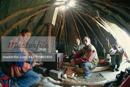 Sami man (Lapplander) inside laavo (tent), drinking moonshine, Finnmark, Norway, Scandinavia, Europe Stock Photo - Rights-Managed, Image code: 841-02945950