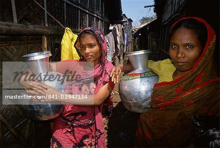 Women with water pots in the slums, Dhaka, Bangladesh, Asia Stock Photo - Rights-Managed, Image code: 841-02947134