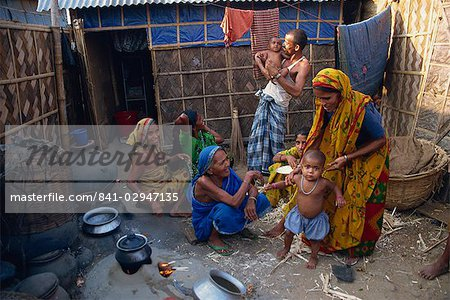 Families in the area outside their shack in a slum in the city of Dhaka (Dacca), Bangladesh, Asia Stock Photo - Rights-Managed, Image code: 841-02947135
