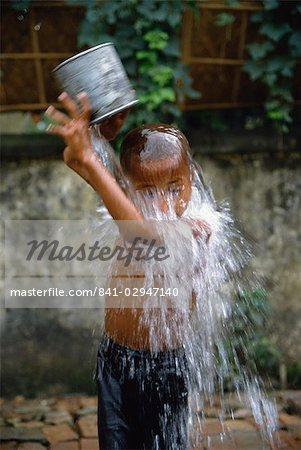Boy bathing in a slum area, Dhaka, Bangladesh, Asia Stock Photo - Rights-Managed, Image code: 841-02947140
