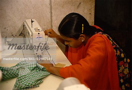 Woman working in garment factory, Dhaka, Bangladesh, Asia Stock Photo - Rights-Managed, Image code: 841-02947141