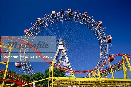 Big wheel with roller coaster, Prater, Vienna, Austria, Europe Stock Photo - Rights-Managed, Image code: 841-03029612