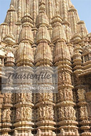 Detail of the main spire with some of the 646 erotic figures carved in sandstone on the Kandariya Mahadeva Temple, largest of the Chandela temples, within Western Group, Khajuraho, UNESCO World Heritage Site, Madhya Pradesh state, India, Asia Stock Photo - Rights-Managed, Image code: 841-03505169
