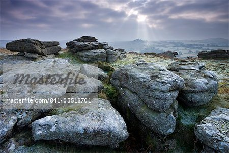 Frosted granite outcrop on Hayne Down, looking towards Hound Tor on the horizon, Dartmoor National Park, Devon, England, United Kingdom, Europe Stock Photo - Rights-Managed, Image code: 841-03518701