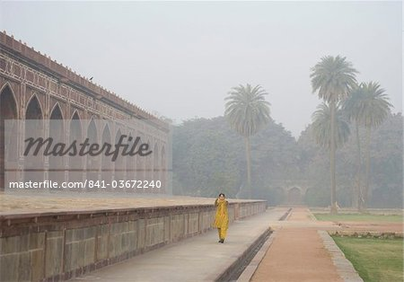 A woman exercising early in the morning in the garden at Humayun's Tomb, New Delhi, India, Asia Stock Photo - Rights-Managed, Image code: 841-03672240