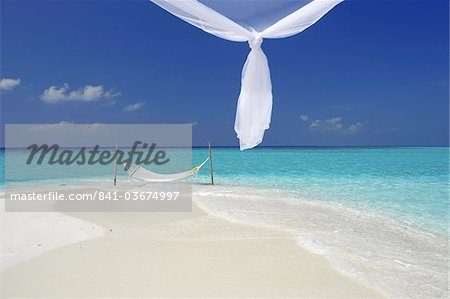 Hammock hanging in shallow clear water, The Maldives, Indian Ocean, Asia Stock Photo - Rights-Managed, Image code: 841-03674997