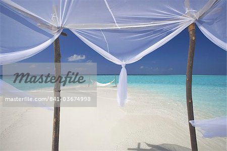 Hammock hanging in shallow clear water, The Maldives, Indian Ocean, Asia Stock Photo - Rights-Managed, Image code: 841-03674998