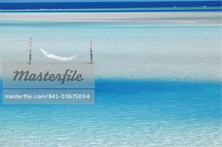 Hammock hanging in shallow clear water, Maldives, Indian Ocean, Asia Stock Photo - Rights-Managed, Image code: 841-03675004