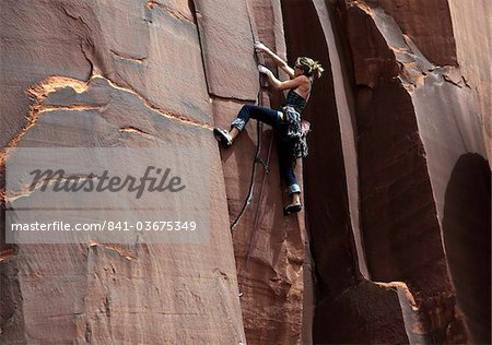 A rock climber tackles an overhanging crack in a sandstone wall on the cliffs of Indian Creek, a famous rock climbing area in Canyonlands National Park, near Moab, Utah, United States of America, North America Stock Photo - Rights-Managed, Image code: 841-03675349