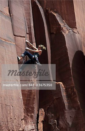 A rock climber tackles an overhanging crack in a sandstone wall on the cliffs of Indian Creek, a famous rock climbing area in Canyonlands National Park, near Moab, Utah, United States of America, North America Stock Photo - Rights-Managed, Image code: 841-03675350