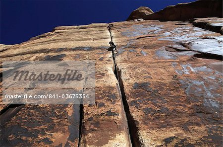 A rock climber tackles an overhanging crack in a sandstone wall on the cliffs of Indian Creek, a famous rock climbing area in Canyonlands National Park, near Moab, Utah, United States of America, North America Stock Photo - Rights-Managed, Image code: 841-03675354