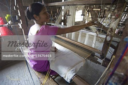 Woman at village silk loom weaving Assam Muga natural undyed silk in Sualkuchi, Assam, India, Asia Stock Photo - Rights-Managed, Image code: 841-03675405