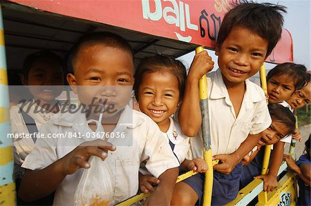 Cambodian children on the way to school, Siem Reap, Cambodia, Indochina, Southeast Asia, Asia Stock Photo - Rights-Managed, Image code: 841-03676036