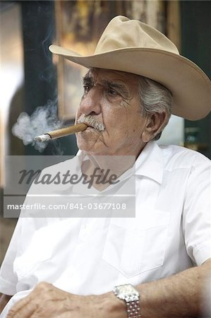 Cuban emigre smoking cigar wearing a cowboy hat in Calle Ocho, Miami, Florida, United States of America, North America Stock Photo - Rights-Managed, Image code: 841-03677108
