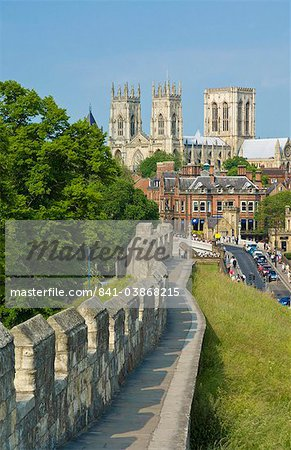 York Minster, northern Europe's largest Gothic cathedral, and a section of the historic city walls along Station Road, York, Yorkshire, England, United Kingdom, Europe Stock Photo - Rights-Managed, Image code: 841-03868215
