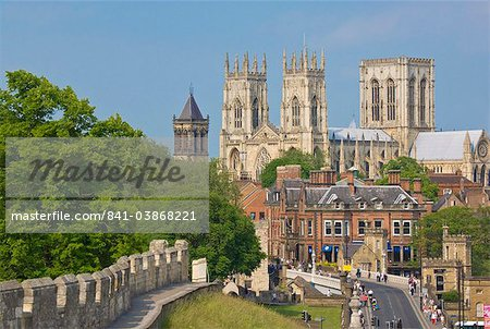 York Minster, northern Europe's largest Gothic cathedral, and a section of the historic city walls along Station Road, York, Yorkshire, England, United Kingdom, Europe Stock Photo - Rights-Managed, Image code: 841-03868221
