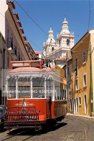 A tram runs along the tourist friendly Number 28 route in Alfama, Lisbon, Portugal, Europe Stock Photo - Rights-Managed, Image code: 841-03871397